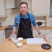 James Deveney cooking in a classroom kitchen